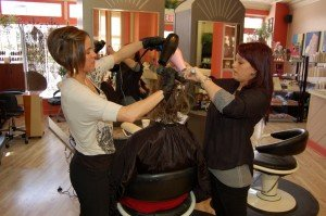 Kristen Pauley and Justine Thomas tag team to finish a client after a GK Treatment at the Glendale Statements in Hair.