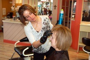 Kristen Pauley executes finishing touches to a Global Keratin Treatment and styling.